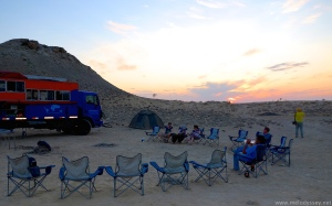 sunset-behind-odyssey-overland-truck-and-camping-chairs-karkoum-dessert-turkmenistan