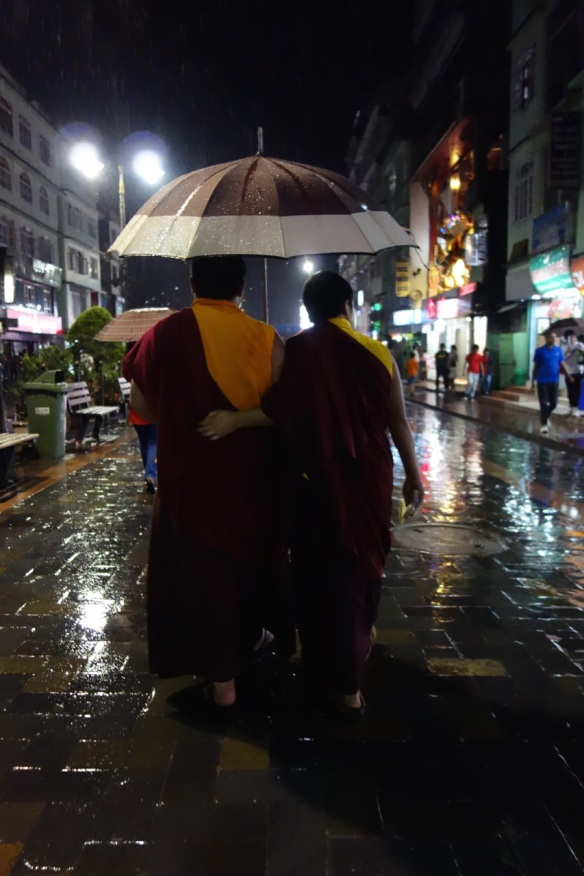 Monks walking in the rain in Gangtok, Sikkim Province, India.