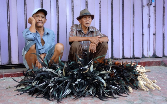 men-selling-feather-dusters-blitar-java-indonesia